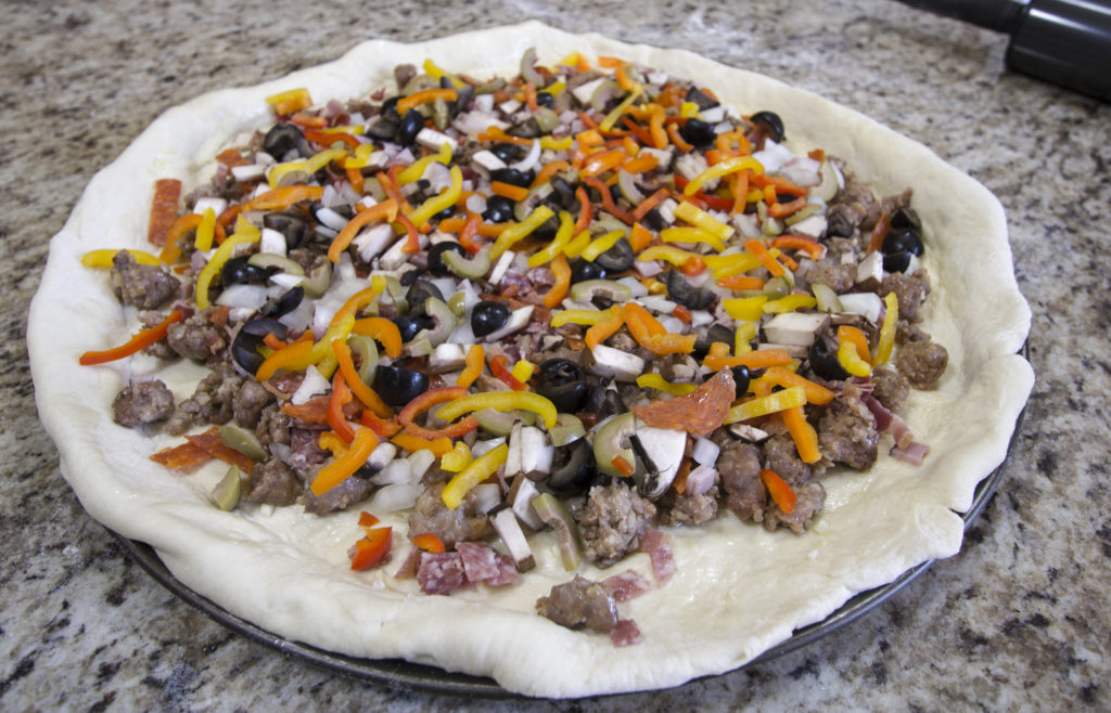 Raw pizza with toppings