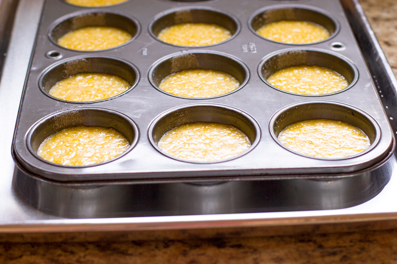 Placing the muffin pans in a ban marie