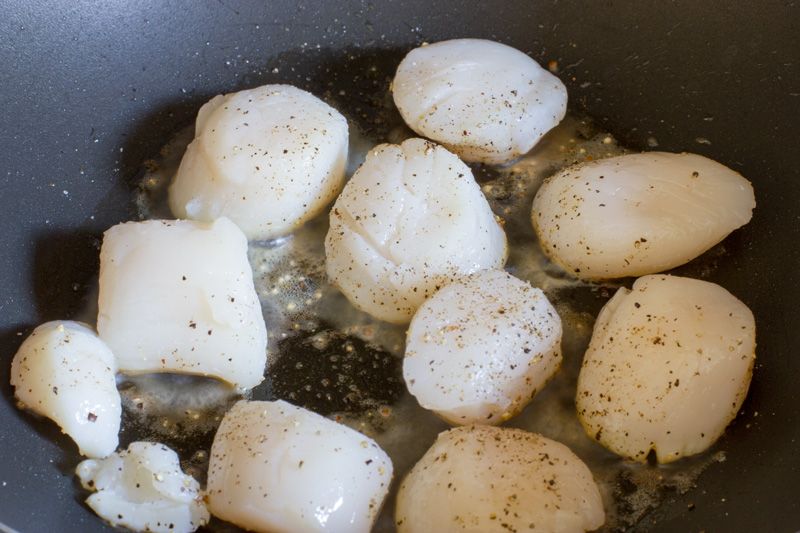 Scallops searing the first side