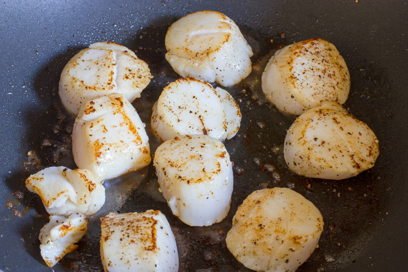 Scallops searing the second side