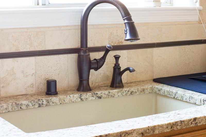 View of the sink mounted under the granite counter