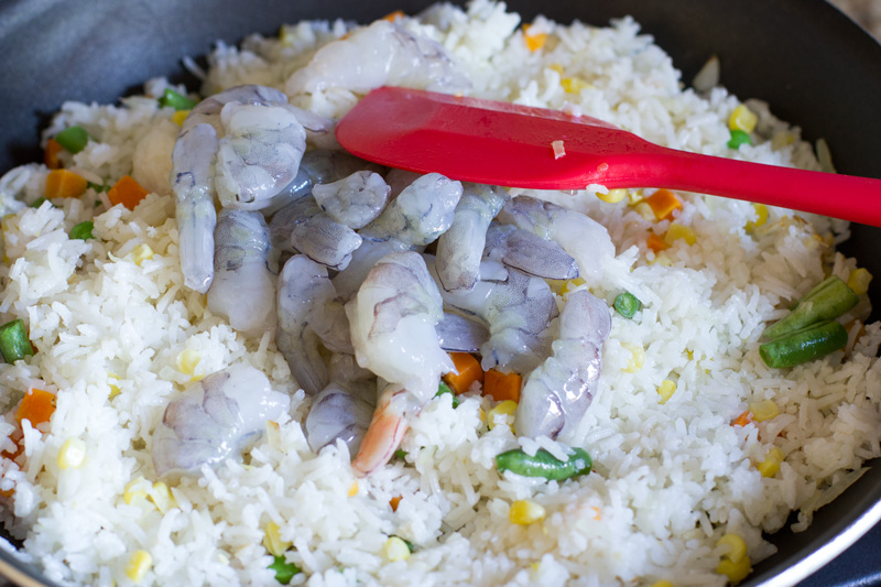 Adding the shrimp to the fried rice