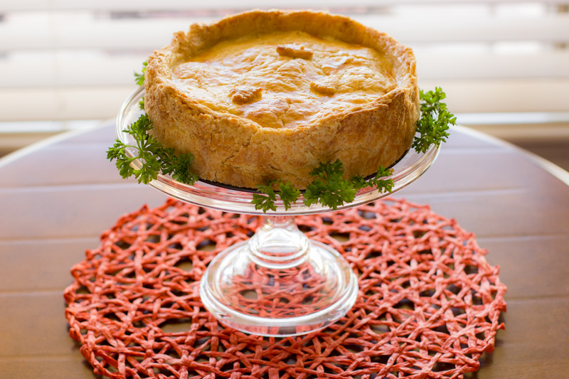 Shrimp and heart of palm pie on cake stand
