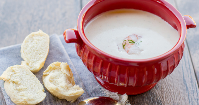 Bisque in a bowl with a side of French bread