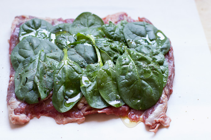 Skirt steak with seasoned spinach layer