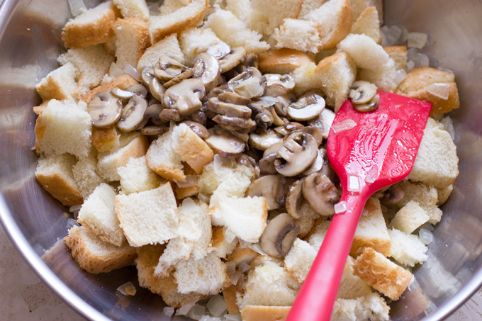 Add sauteed mushrooms to the bread and onion mixture