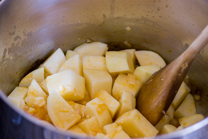 Adding the potatoes to the pot