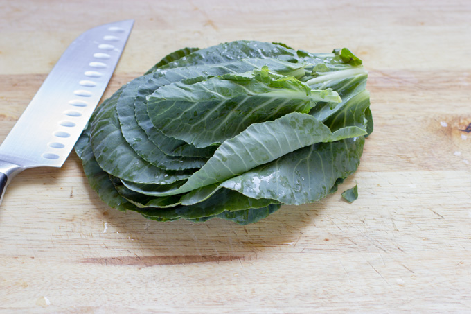 Stacked collard green leaves