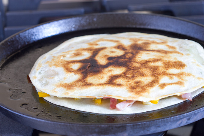 Quesadilla cooking on the second side