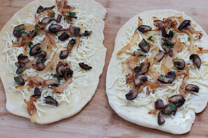 Adding caramelized onions and mushrooms to the toppings