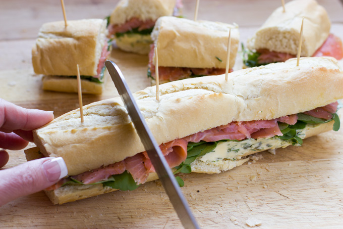 Cutting the smoked salmon baguette into portions