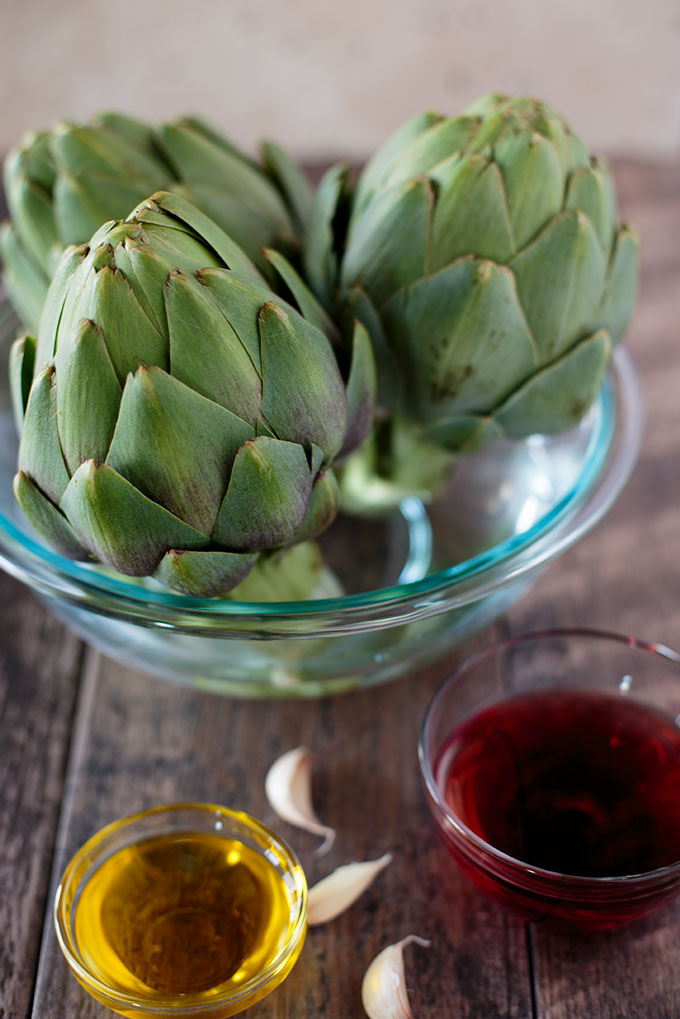 Keeping the artichokes fresh in a bowl of water