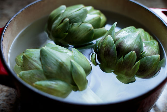 Artichokes in the pan for boiling
