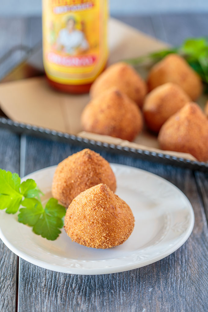 Two coxinhas on a plate