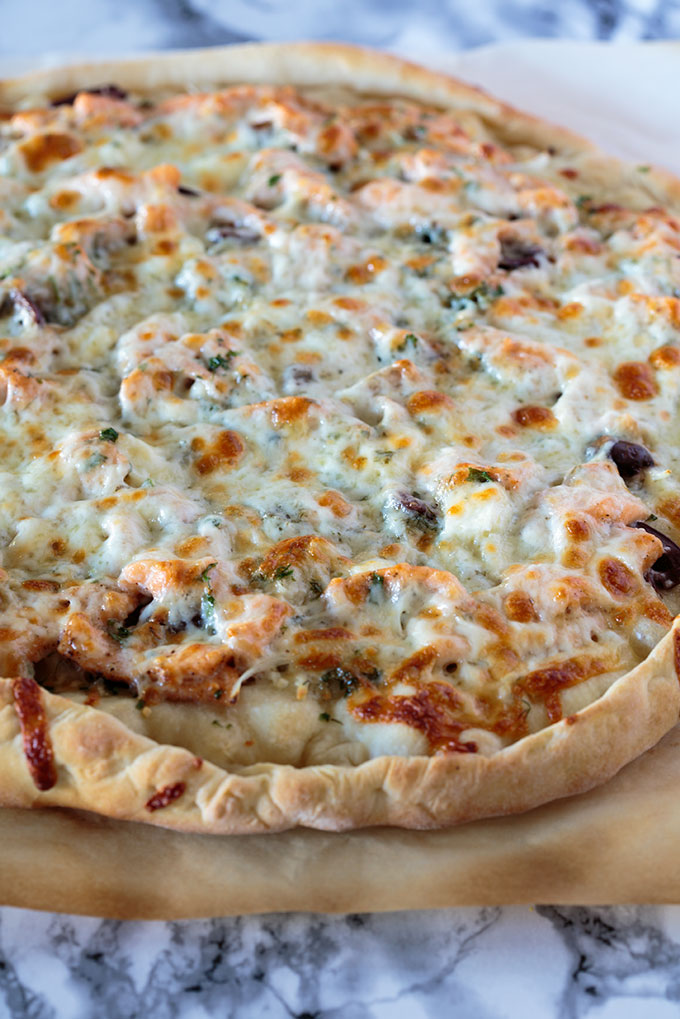 Cooked salmon and herb pizza