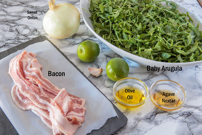 Wilted arugula and bacon salad ingredients