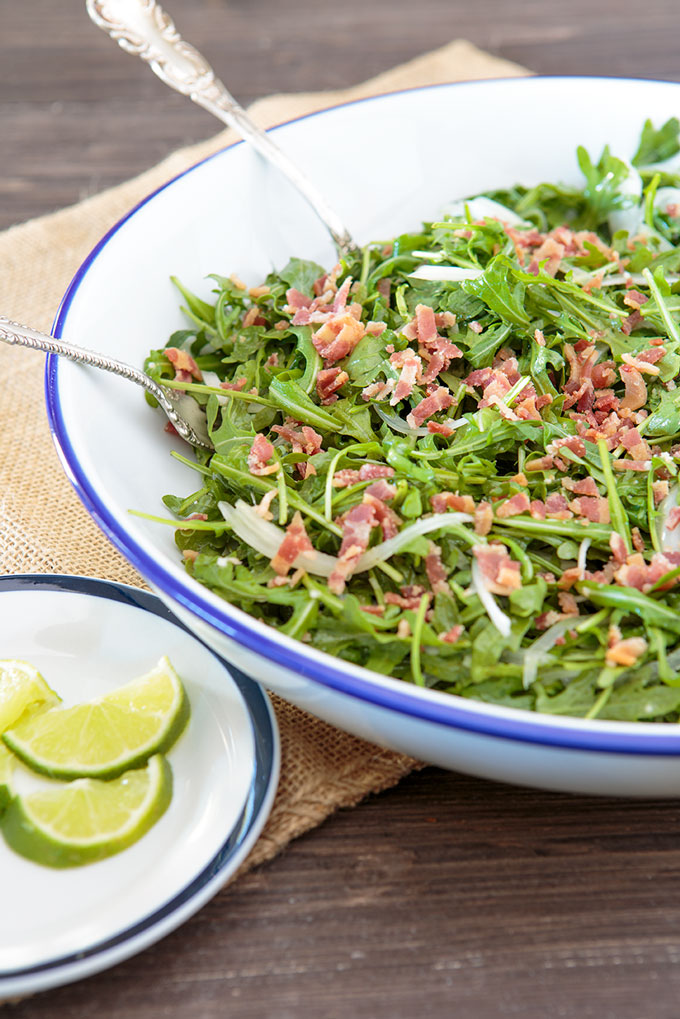 Wilted arugula and bacon salad in a platter