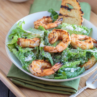 Feature image of the southwest Caesar salad on a plate with a crostini
