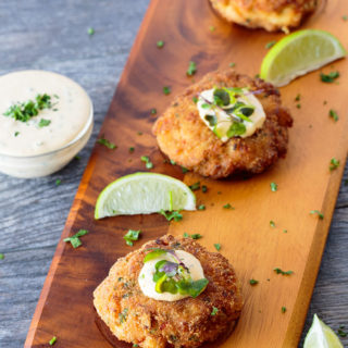 Fish cakes on a serving board feature image