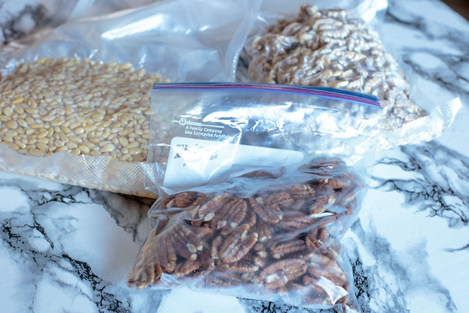 Pine nuts, walnuts, and pecans frozen in sealed bags