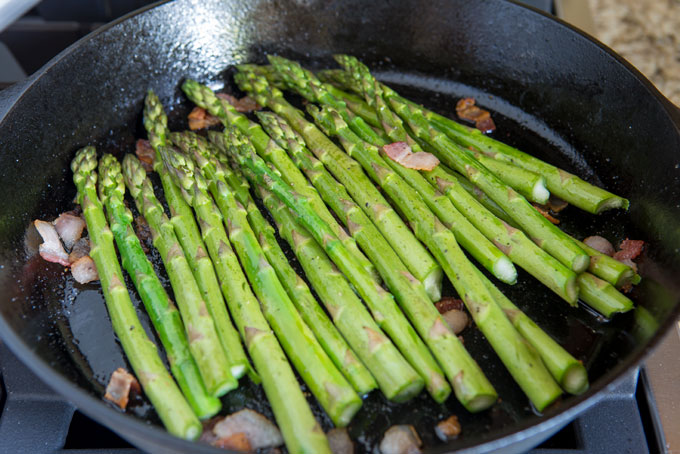 Add the asparagus to the rendered bacon