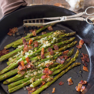 Skillet asparagus with bacon with tongs