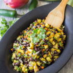 Black bean and mango salad in a platter, feature image