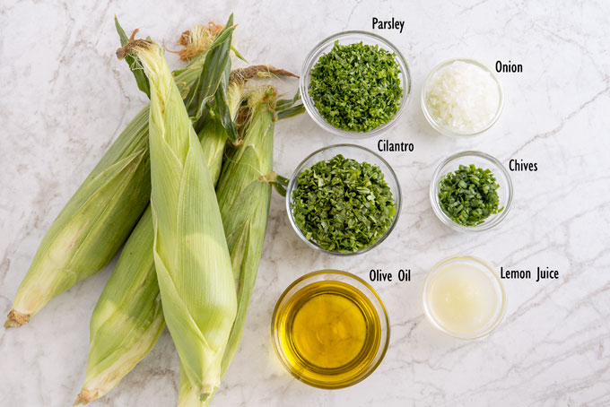 Ingredients for making grilled corn with herbs