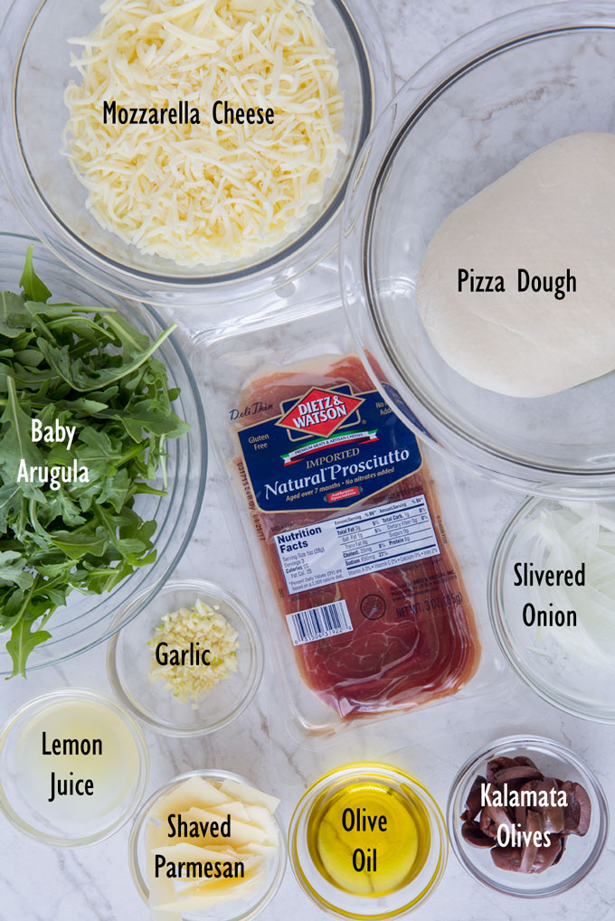 Ingredients for prosciutto and arugula pizza