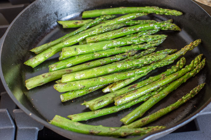 Asparagus grilling in the skillet