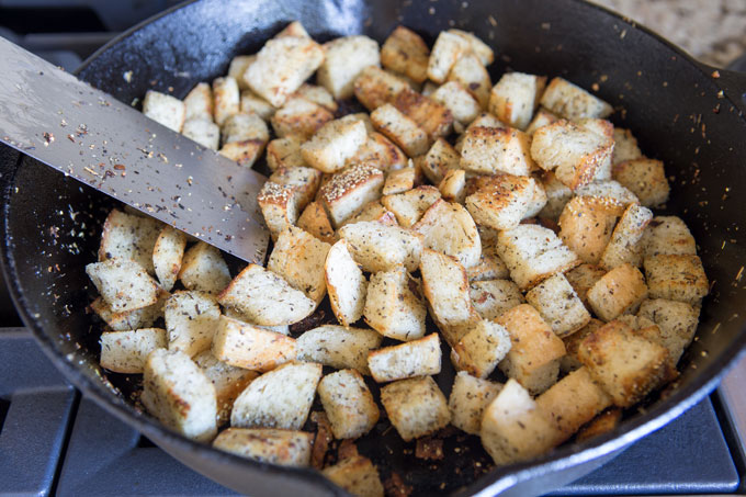 Grilling the croutons in the cast iron skillet