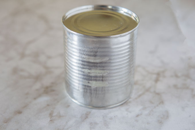 Condensed milk can for milk caramel spread, label adhesive removed