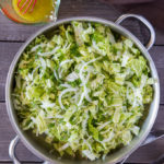 Napa cabbage salad with dressing in a serving platter