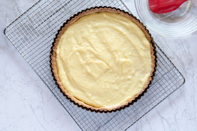 Cooked and cooled tart crust with pastry cream