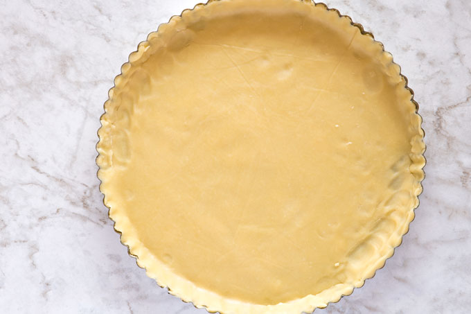 Spring form tart pan with trimmed dough
