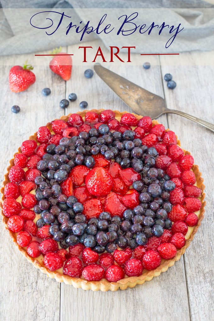 Triple berry cream tart on a table with text banner