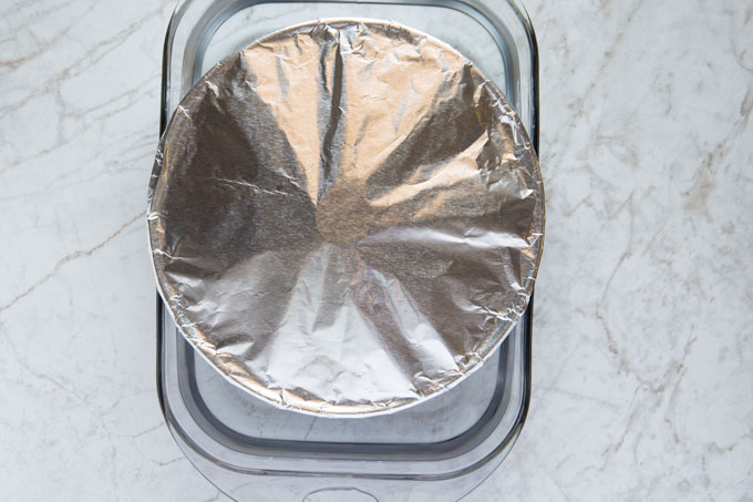 Flan in the tube pan, covered with tin foil, in a bain-marie