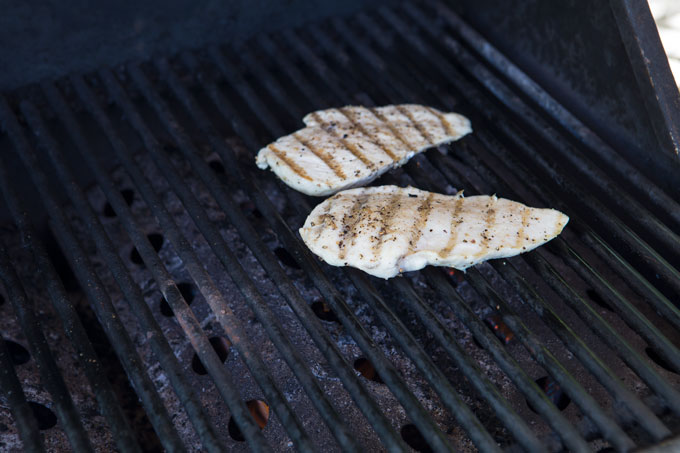 Grilling the chicken breasts for the grilled chicken Caesar sandwich