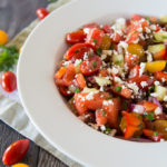 Prepared tomato watermelon feta salad on a serving platter