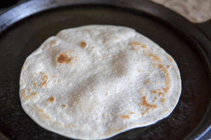 Cooking the tortillas for the Texas breakfast tacos
