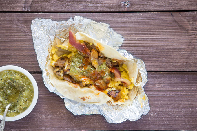 Texas breakfast taco in foil with tomatillo salsa