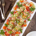 Lobster salad on a platter with green goddess dressing