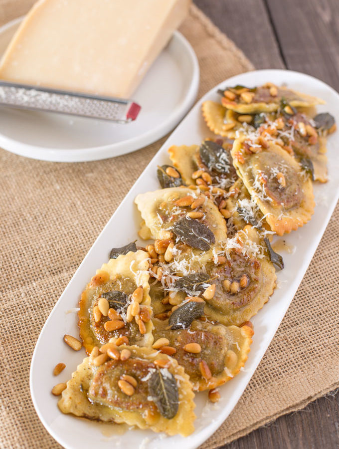 Mushroom agnolotti with toasted pine nuts in sage brown butter