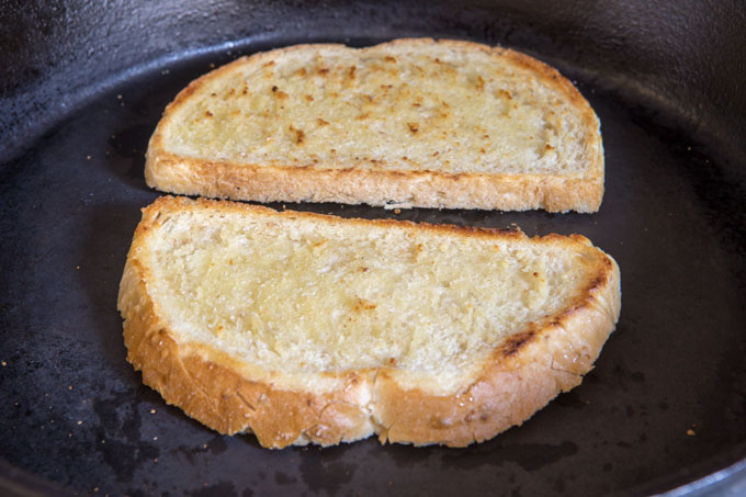 Pan toasting the sourdough slices for the salmon BLT