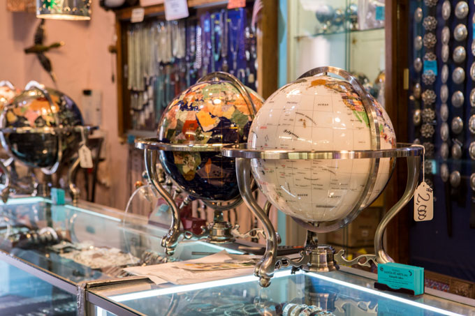 Globes made of polished rocks in store in Santa Fe