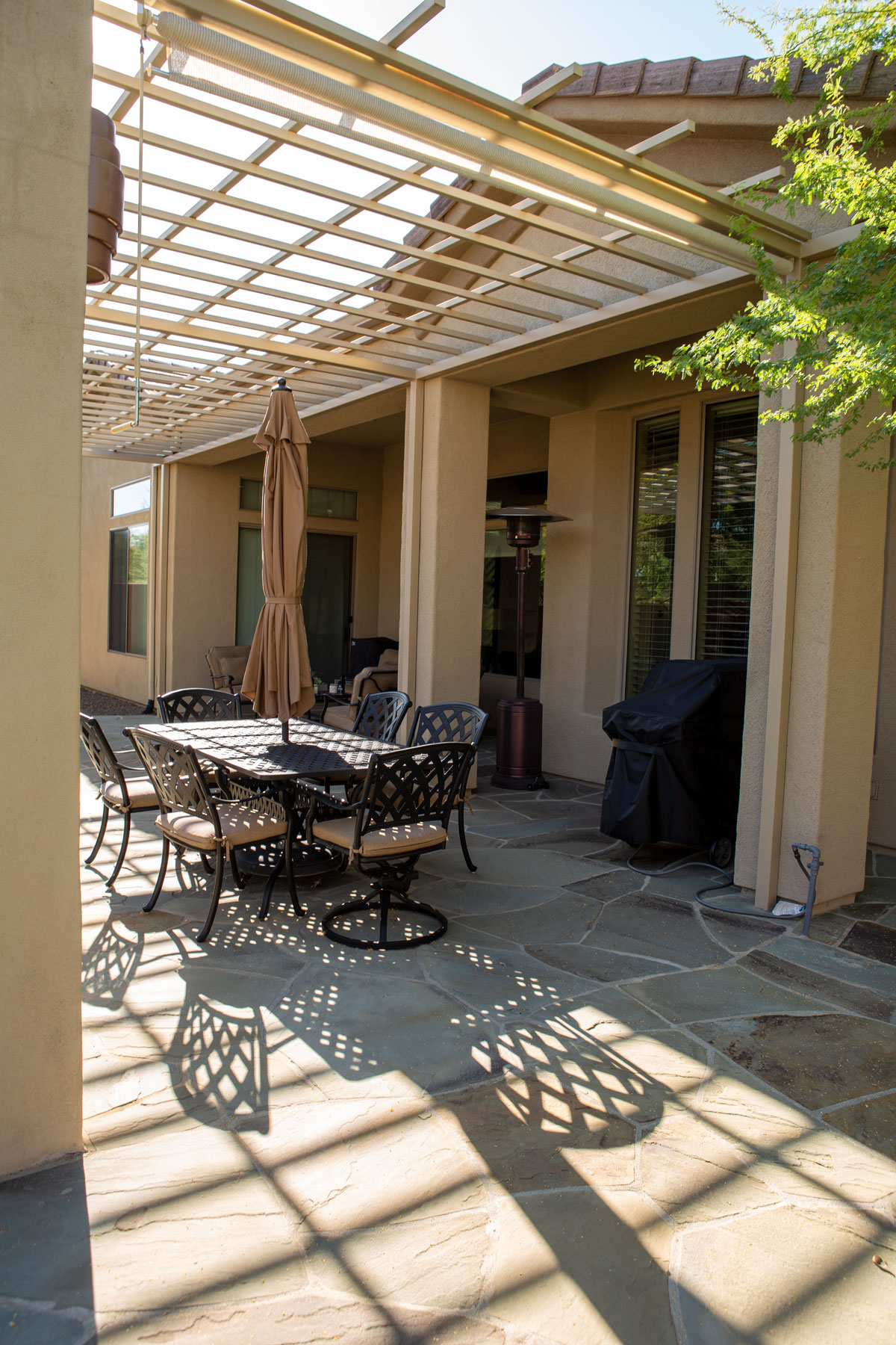 outdoor dining area under pergola