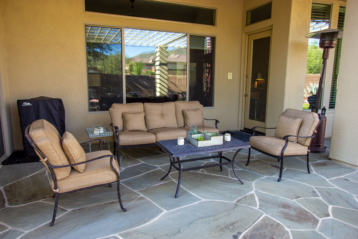 covered patio with furniture