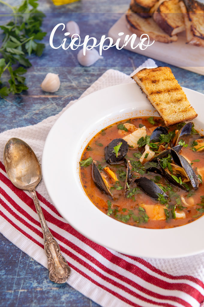 Feature image of plated cioppino with name banner
