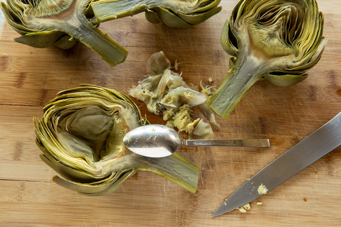 Cleaning the inner leaves and the choke for the artichoke piccata