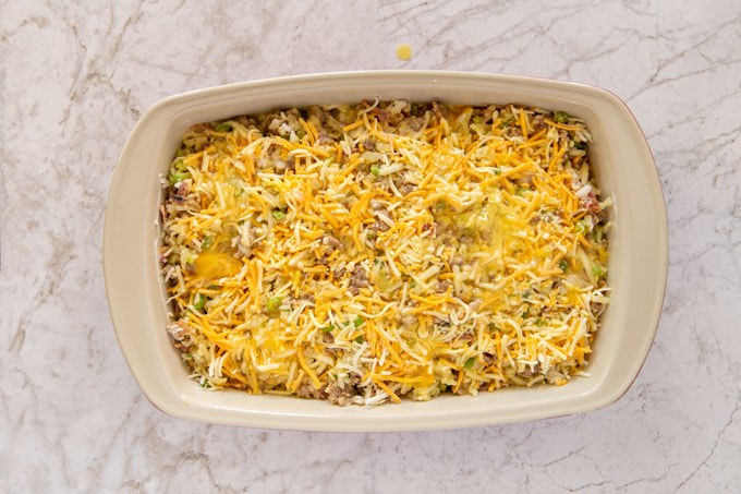 Assembled breakfast casserole with the egg mixture poured in before banking